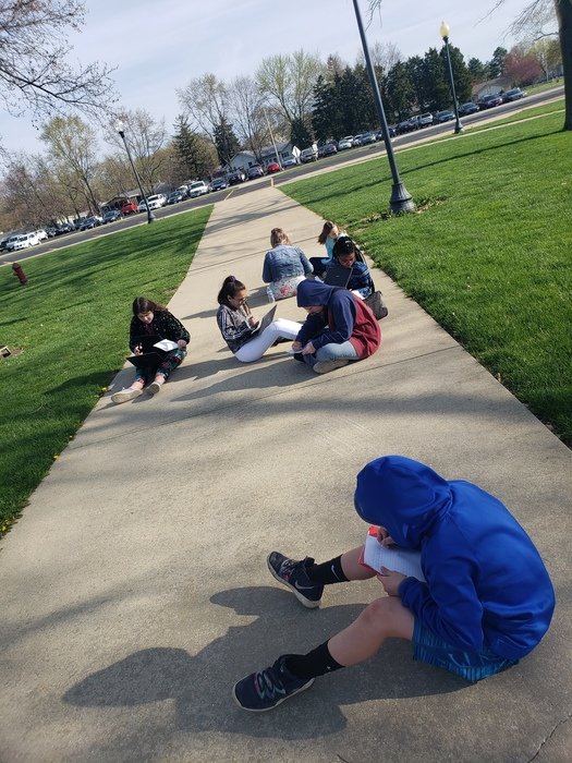 Two seventh-grade language arts classes earned a reward for good behavior this week. Students enjoyed the spring weather while working on fictional narratives.