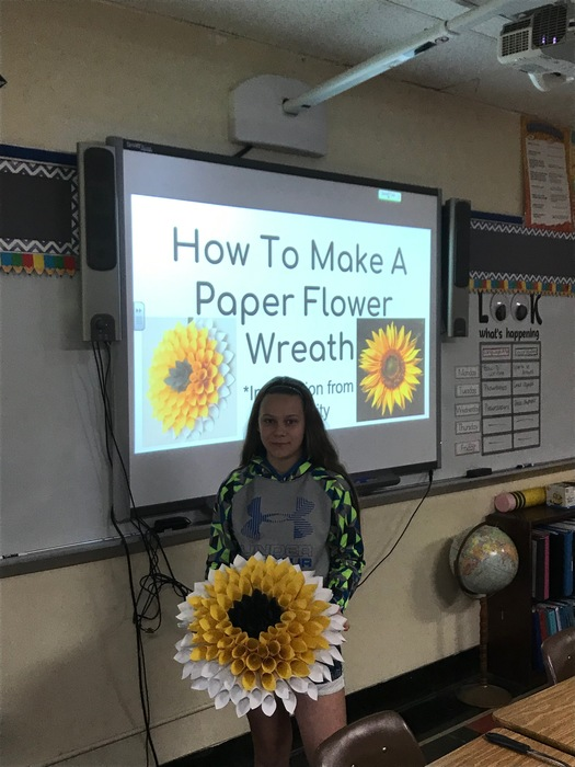 Learning to make a paper flower wreath!