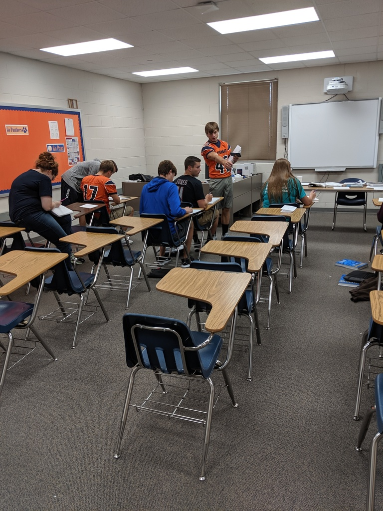 Calculus students work together to solve equations.