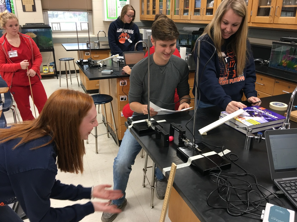 Students working on projectile motion lab.