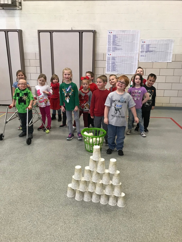 Mrs. Reynolds class celebrating Holiday Sweaters and showing off their cup stacking skills!