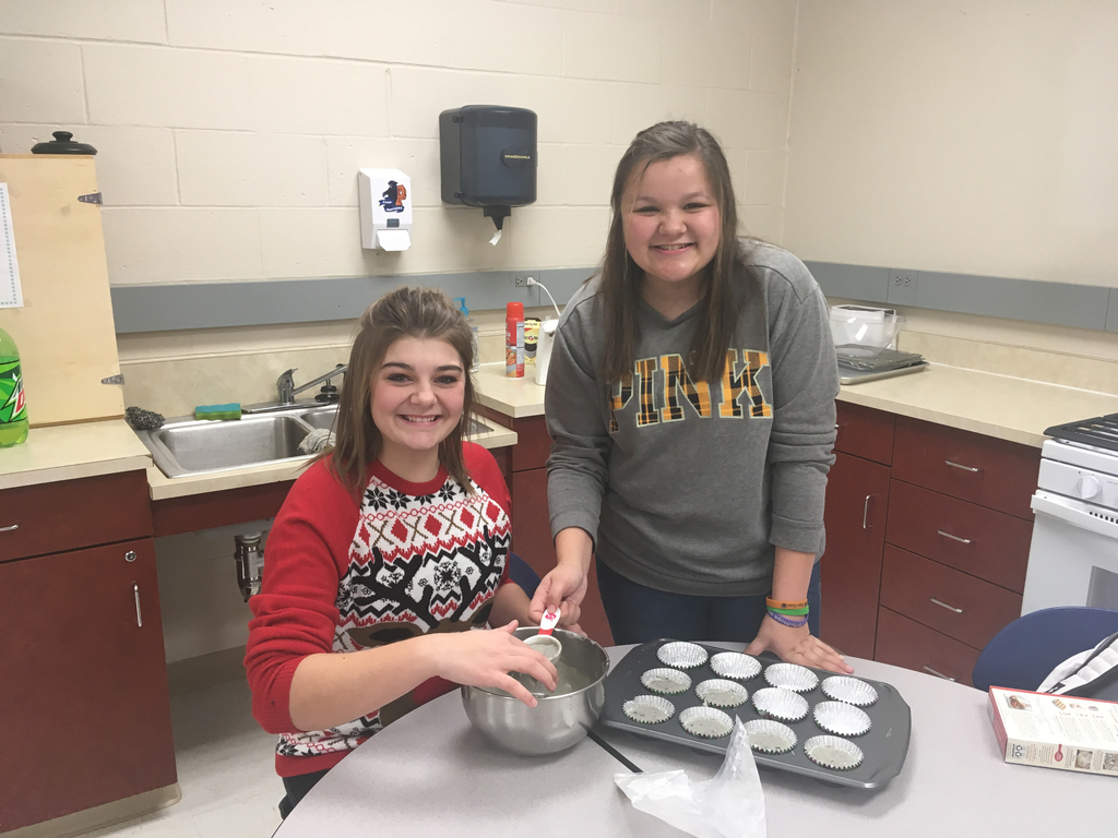 Good Deeds Group members making muffins.