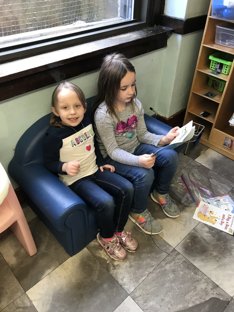 Rae reading to her pre-k friend